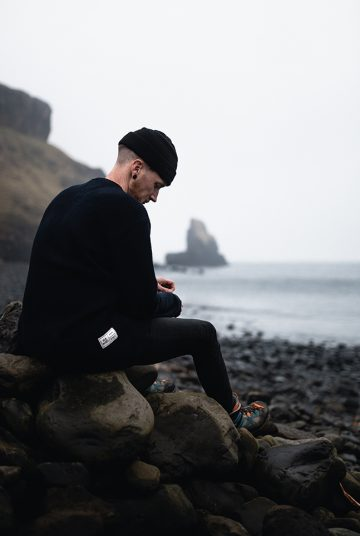 Exploring the coast of Scotland in jumper and hat